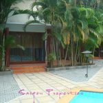 Front of house by swimming pool